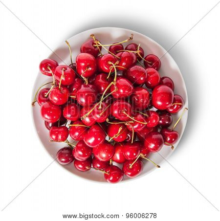 Red Sweet Cherries In White Plate Top View