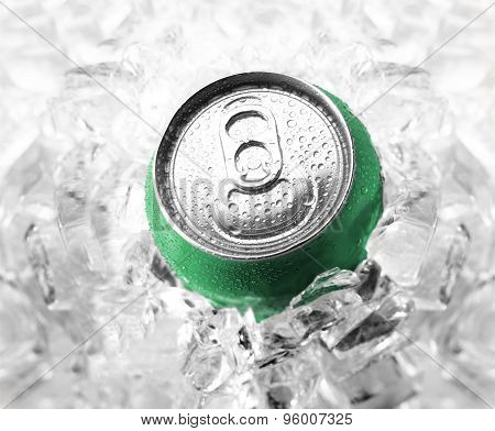 Green soda can in ice