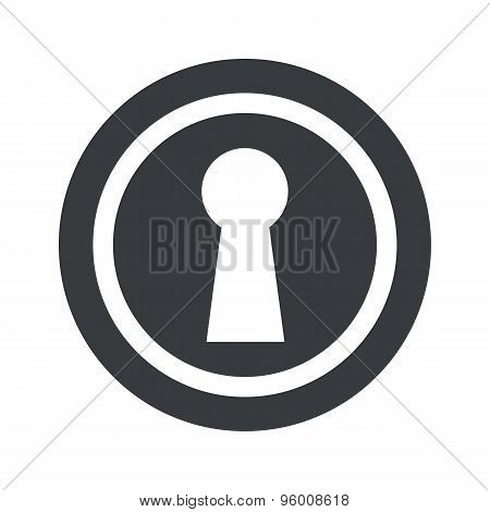 Round black keyhole sign