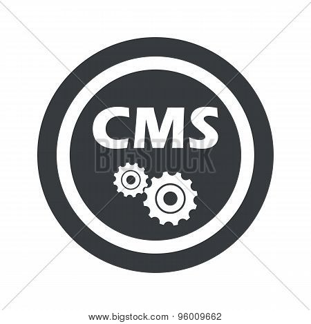 Round black CMS settings sign