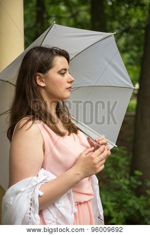 Romantic Girl In A Light Pink Tunic In A Park