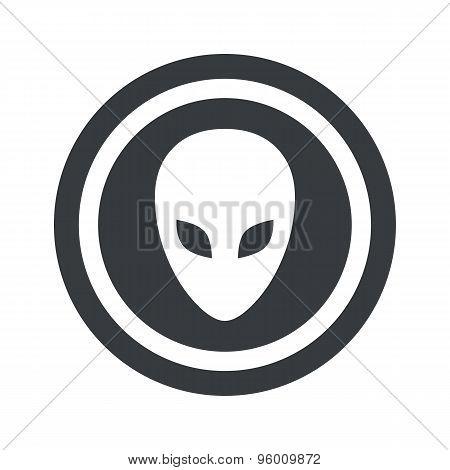 Round black alien sign