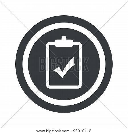 Round black clipboard YES sign