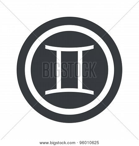Round black Gemini sign