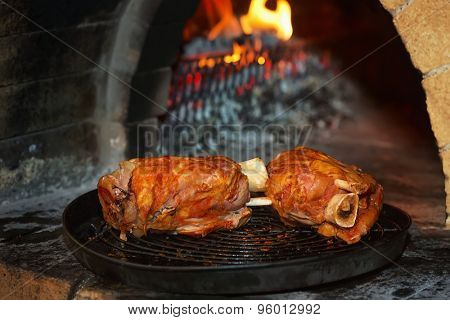 Roasted pork knuckle baked in a brick oven