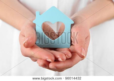 Woman holding model of house close up