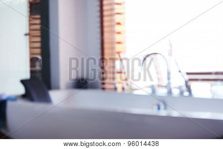 Faucet of whirlpool in bathroom, blurred texture background