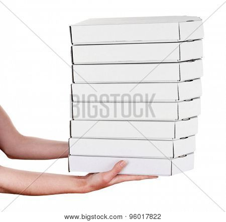 Hands holding pizza boxes isolated on white