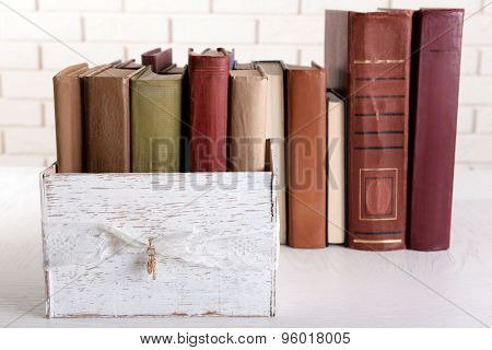 Heap of old books on table close up