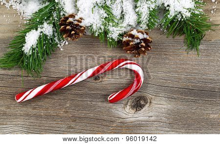 Christmas Border With Snow Covered Branches And Decorations On Rustic Wooden Boards