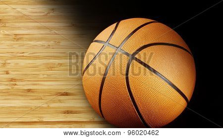 Closeup of a basketball on wooden floor