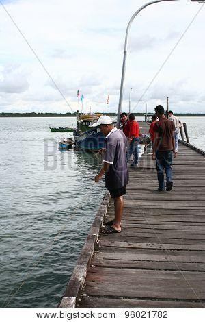 Fisherman caught fish at dawn in Muara Terbas village, Kuching, Sarawak