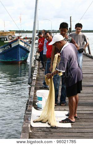 Fisherman caught fish in Muara Terbas village, Kuching, Sarawak
