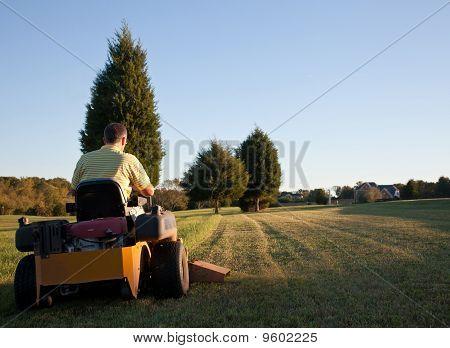 Senior Mowing Lawn