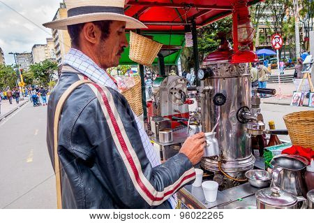 Unidentified street vendor selling fresh coffee at Candelaria neighborhood in Bogota Colombia
