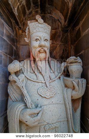 Guardian Statue at Wat Arun - the Temple of Dawn in Bangkok, Thailand