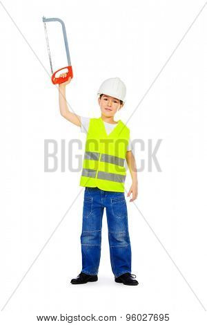 Eight years old boy in a costume of a builder posing with a saw. Isolated over white. Full length portrait.