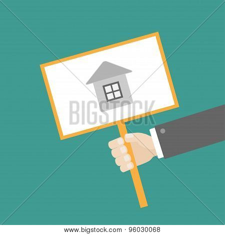 Businessman Hand Holding Paper Blank Sign Plate With House On The Stick Flat Design