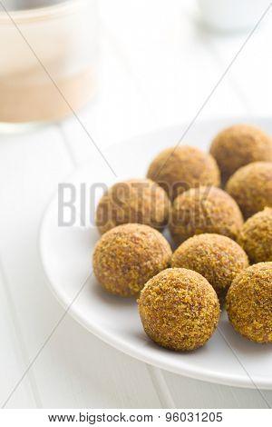 sweet truffles on white plate