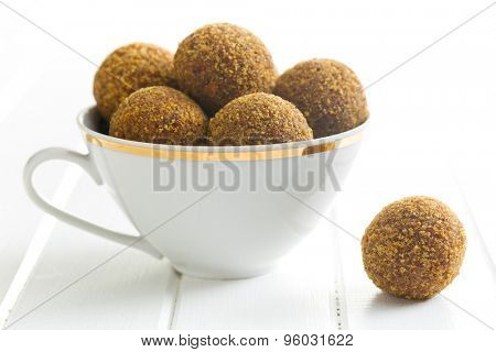 sweet truffles in mug on kitchen table