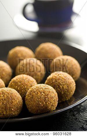 sweet truffles on black plate
