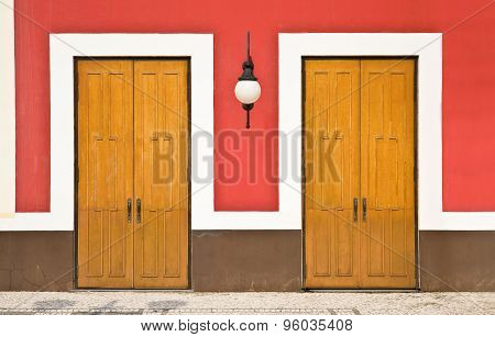 Two doors against color wall