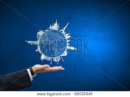 Close up of businessman hand with Earth planet in palm