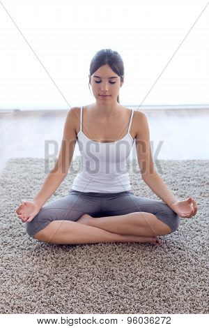 Beautiful Young Woman Doing Yoga Exercises At Home.