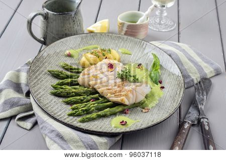 saithe fillet with green asparagus