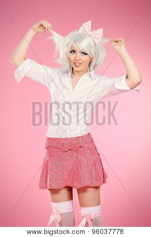Cute teen girl wearing white wig and school uniform with stockings posing over pink background. Anime style.