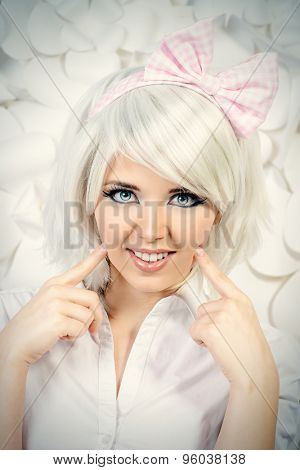 Close-up portrait of a lovely girl wearing white wig and white blouse posing over  background with paper flowers. Anime style.