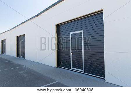 storage, building structure and architecture concept - garage or warehouse exterior