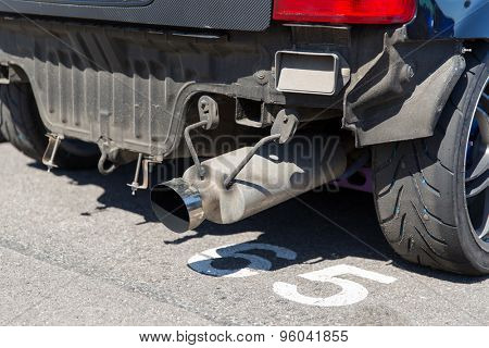 transportation, freight transport and vehicle parts concept - close up of truck exhaust pipe