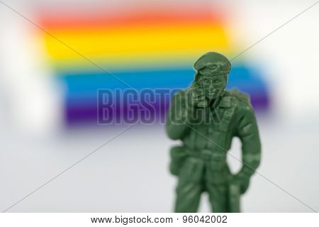 Sofia, Bulgaria - July 16, 2015: Plastic toy soldier casting model figure shot on blurred rainbow