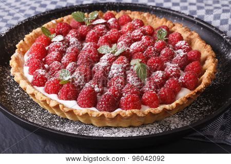 Delicious Tart With Fresh Raspberries  On A Plate Close-up Horizontal
