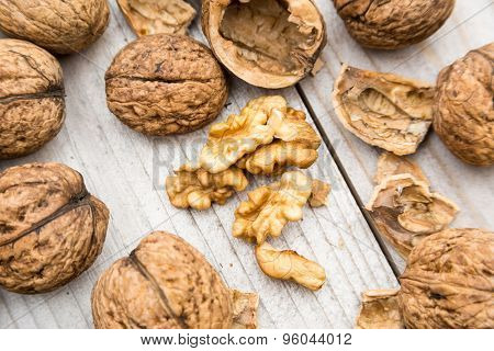 Fresh raw organic walnuts on wood
