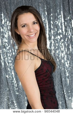 Beautiful woman wearing formal dress smiling