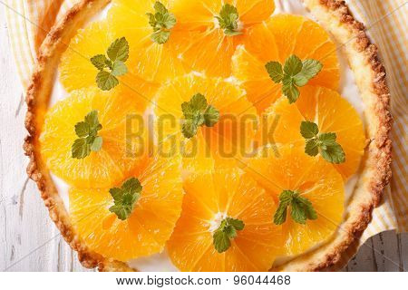 Orange Tart With Cream And Mint Macro. Horizontal Top View