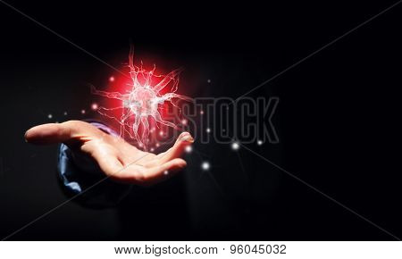Close up of businessman holding digital image of nerve in palm