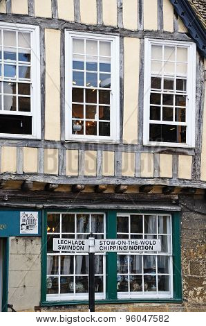 Signpost and shop, Burford.
