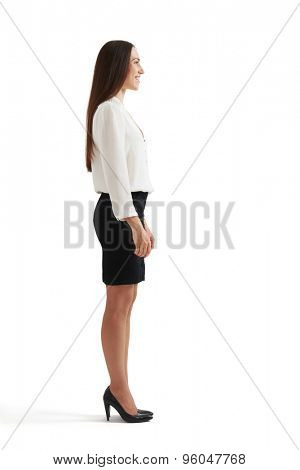 full-length sideview portrait of businesswoman in formal wear. isolated on white background