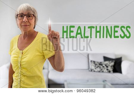 Healthiness Touchscreen Is Shown By Senior Woman