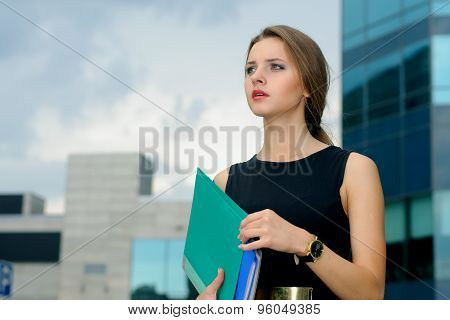 Business Woman With Folders For Papers In Her Hands