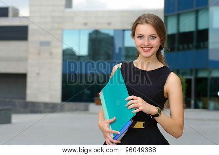 Business Female With Folders For Papers In Her Hands