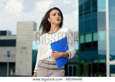 Business Woman With Blue Folder In Her Hand