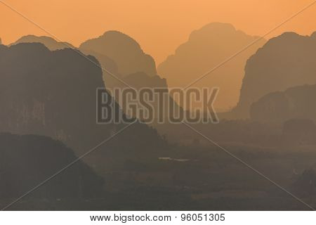 Silhouetted mountains at dusk in the Krabi province, Thailand