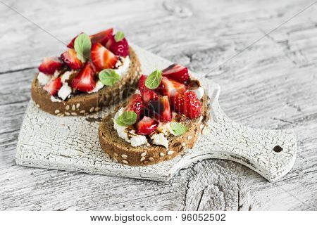 Sandwich With Strawberries, Soft Cheese And Balsamic Vinegar On A Light Wooden Background