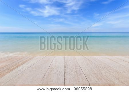 Top Wooden Table And Blur Of Tropical Beach Background