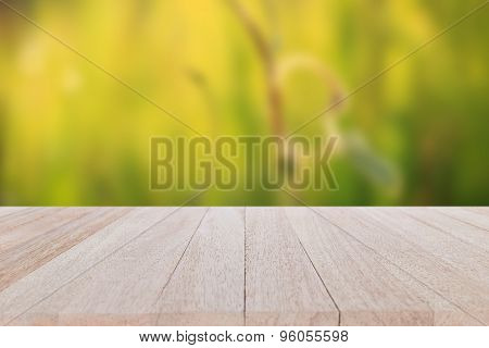 Top Wooden Table On Blur And Bokeh Background