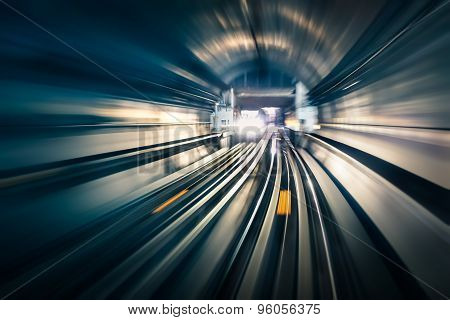 Subway Tunnel With Blurred Light Tracks With Arriving Train In The Opposite Direction